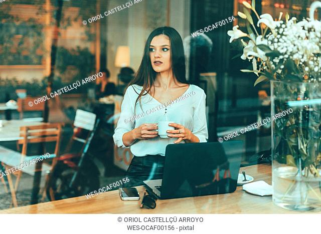 Portrait of young businesswoman waiting in a coffee shop