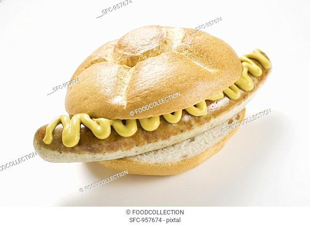 Sausage and mustard in bread roll