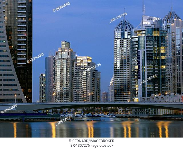 High-rise buildings at dusk at the marina in the Dubai Marina district, Dubai, United Arab Emirates, Middle East