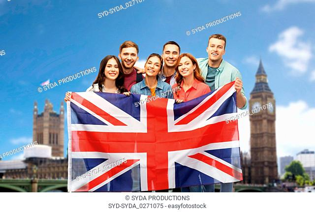 group of friends with british flag over big ben
