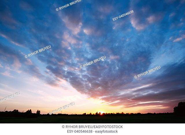 Sunset, Sunrise Over Forest. Bright Dramatic Sky And Dark Ground. Countryside Landscape Under Scenic Summer Dramatic Sky In Sunset Dawn Sunrise