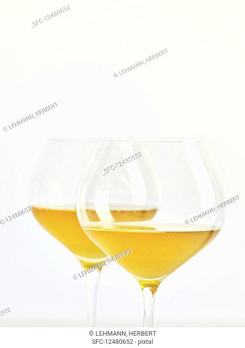 Two glasses of natural wine (orange wine)