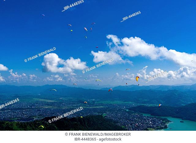 Many paragliders are flying over Pokhara and Phewa Lake, Sarangkot, Kaski District, Nepal