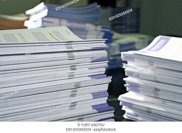 Piles of handout papers lying on table