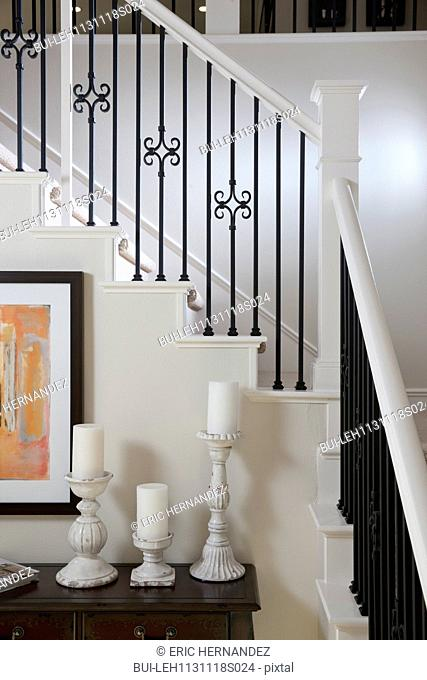 Close-up of candle holders on table against handrails at home; Irvine; California; USA
