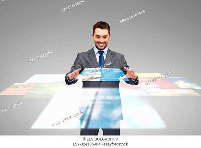 business, multimedia, technology and people concept - smiling businessman working with news projection on virtual screen