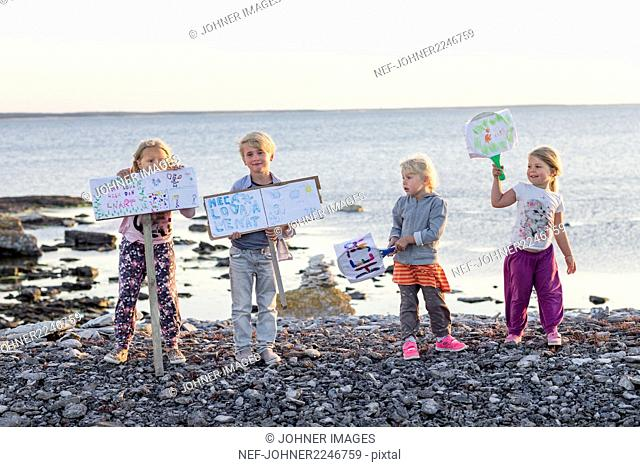 Children with banners on beach