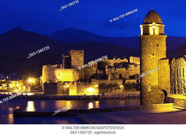 France, Languedoc-Roussillon, Pyrennes-Orientales Department, Vermillion Coast Area, Collioure, Chateau Royal and Eglise Notre Dame des Anges, evening