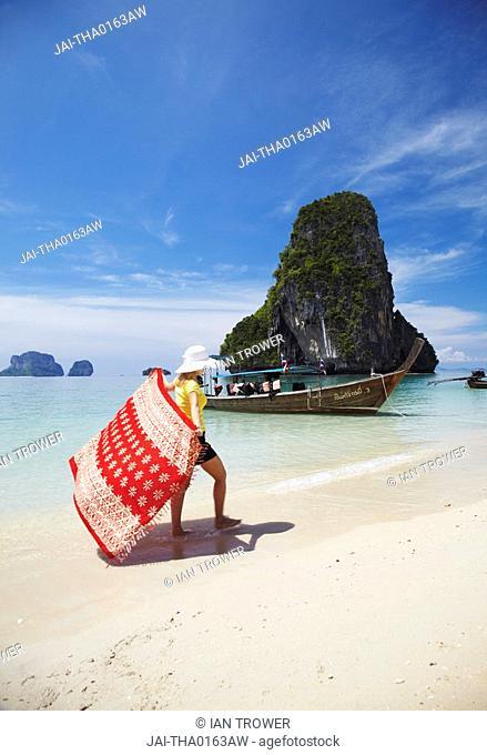 Woman walking on Hat Tham Phra Nang beach, Railay, Krabi Province, Thailand MR