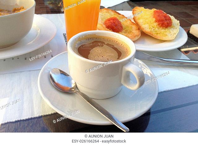 Spanish breakfast with tomatoe and oil toast, orange juice and coffee with milk