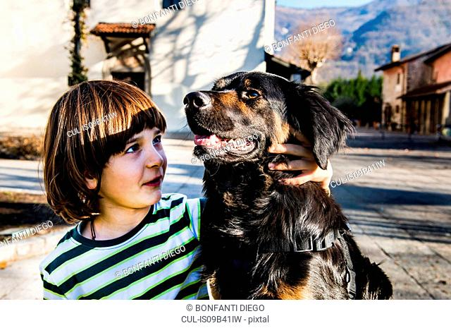 Boy playing with his best friend, his pet dog