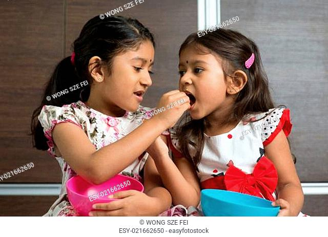Sibling sharing food