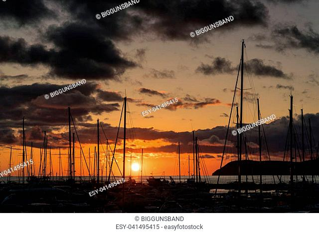 Sunset behind the yachts at marina in Bar city in Montenegro