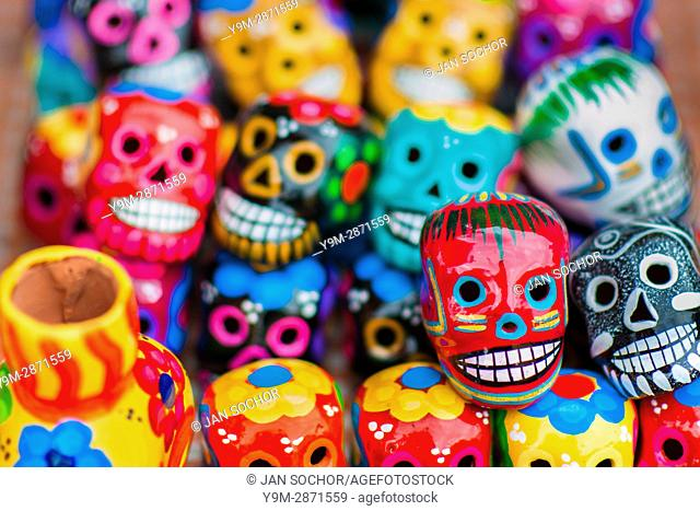 Colorful painted skulls are sold on the market during the Day of the Dead festival in Mexico City, Mexico, 28 October 2016