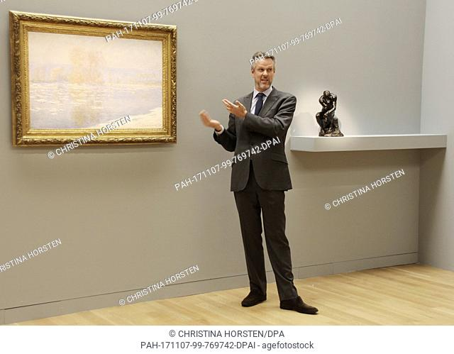 Sotheby's expert Simon Shaw stands in front of an artwork by Claude Monet (Les Glacons, Bennecourt) at Sotheby's in New York, US, 3 November 2017