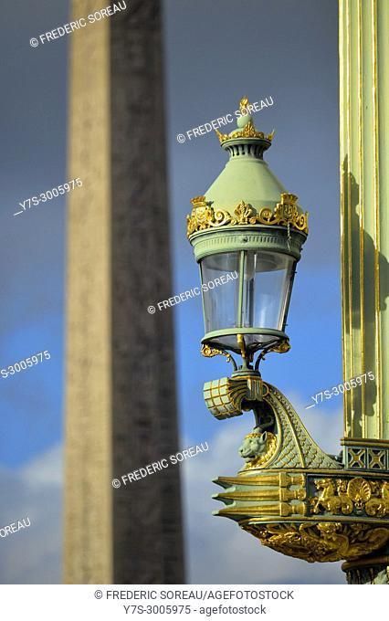 Lamp post with obelisque on background, Place de la Concorde, Paris, France
