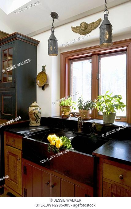 KITCHENS: David T Smith furniture style cabinets historic paint finishes, dark display and storage cabinet, black soapstone farmers sink area