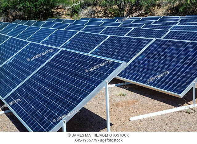 An array of solar panels producing electricity at the Biosphere 2 research facility in Oracle, Arizona USA