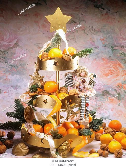 Christmas pyramid with tangerines and nuts