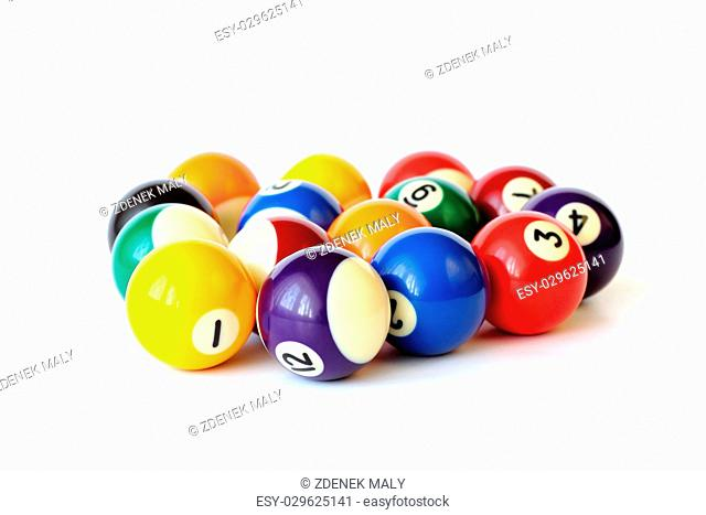 Brightly colored pool or billiard balls on white backgound
