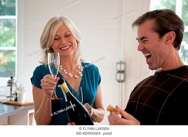 Couple with champagne laughing