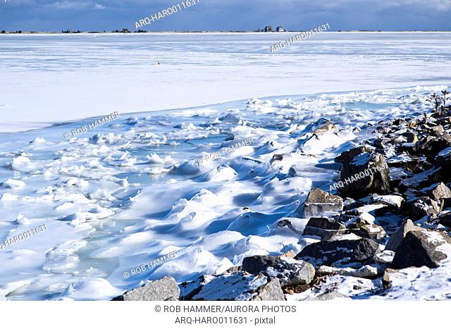 Scenery of frozen shore in winter of harbor in Plymouth, Massachusetts, USA