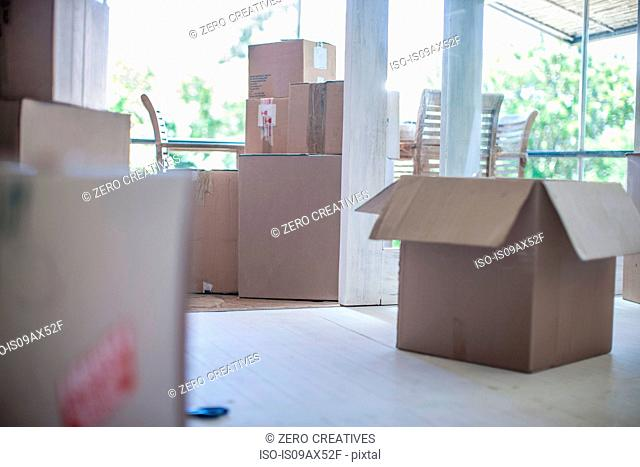 Moving house: Room filled with cardboard boxes