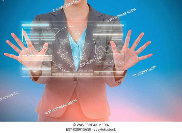 Composite image of businesswoman using digital screen