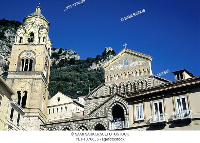 Exterior of the Amalfi Cathedral with cliffs in the background, Amalfi Coast, Italy