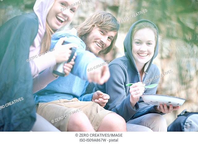 Young group of people eating and drinking outdoors