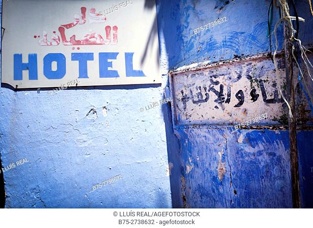 Hotel sign on blue wall. Chaouen, Morocco