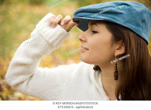 Young woman with blue cap