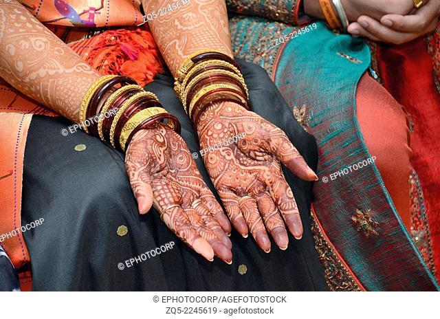 Mehendi or henna decorations on bride's hands. Pune, Maharashtra