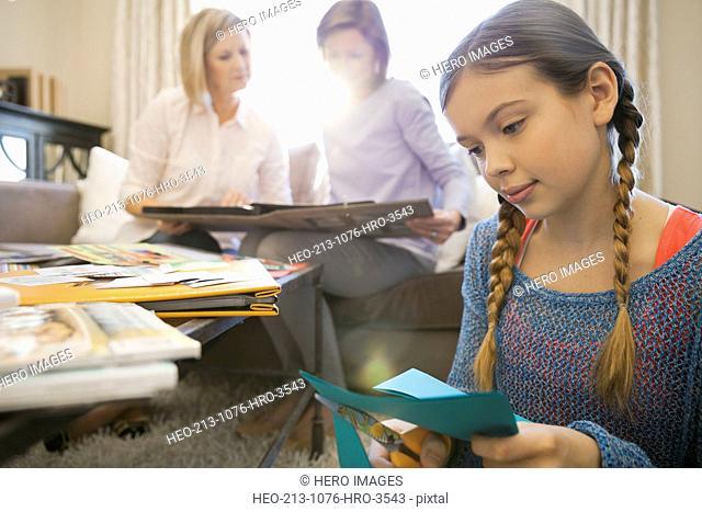 Girl scrapbooking at home