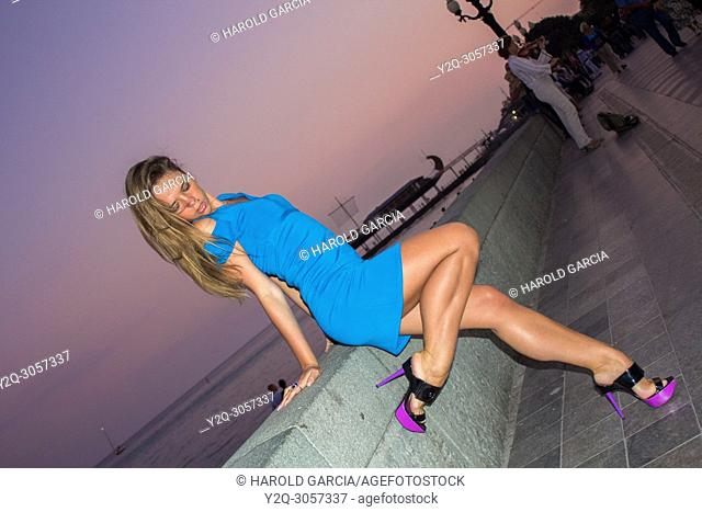 Beautiful woman posing for the camera in different sensual positions in beautiful sunset in Yalta, Crimea