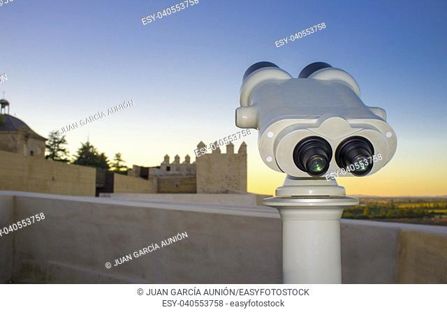 Touristic telescope at Alcazaba of Badajoz, an ancient Moorish citadel, Extremadura, Spain. Sunset