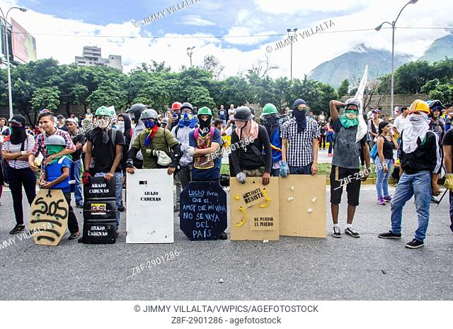 Warriors waiting. Opposition protesters assembled on the Francisco Fajardo motorway, near Francisco de Miranda Air Force Base in La Carlota