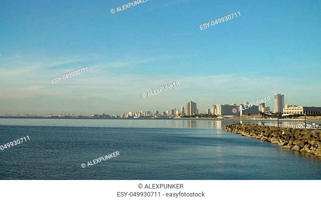 Manila city, skyscrapers and buildings. Seascape coastal city of Manila. Modern city by sea. Makati district. Travel concept