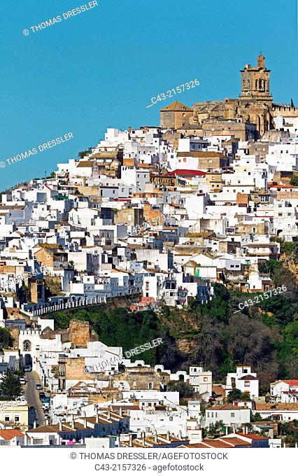 The White Town of Arcos de la Frontera on a limestone rock. Arcos de la Frontera, Cádiz province, Andalusia, Spain