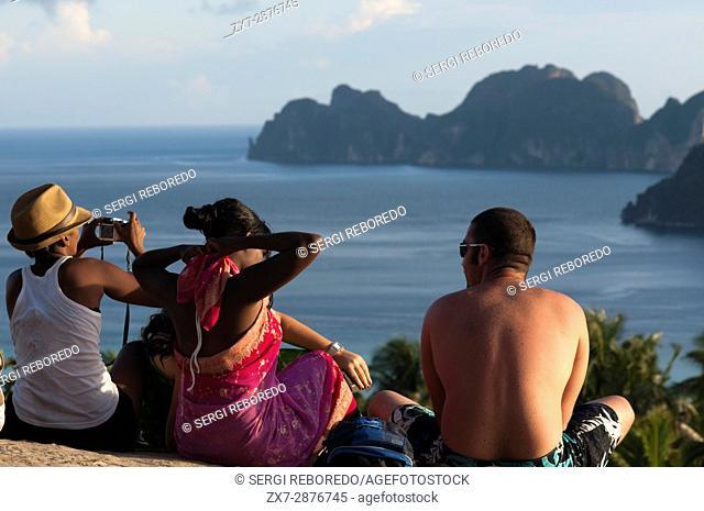 Tourists at Pee Pee viewpoint in Phi Phi Don island. Krabi province, Andaman Sea, Thailand. Ko Nok and Ton Sai Village from Ko Nai viewpoint, Ko Phi Phi