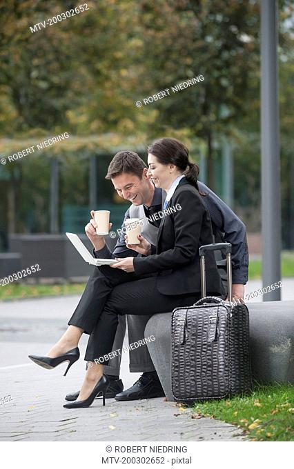 Travelling business executives working together on a laptop, Bavaria, Germany
