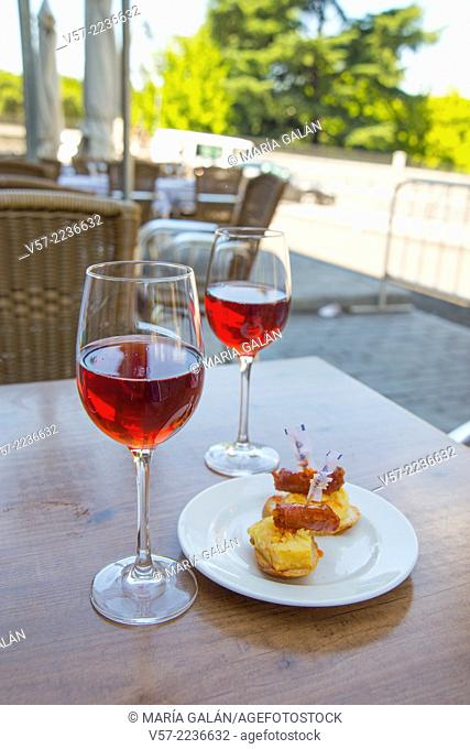 Spanish aperitif: two glasses of rose wine with tapa in a terrace. Madrid, Spain
