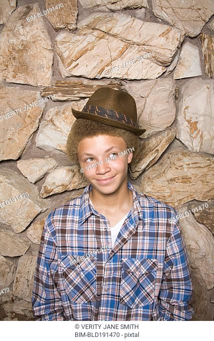Mixed race boy wearing fedora