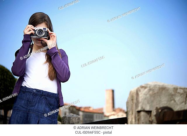Girl taking photograph, Province of Venice, Italy