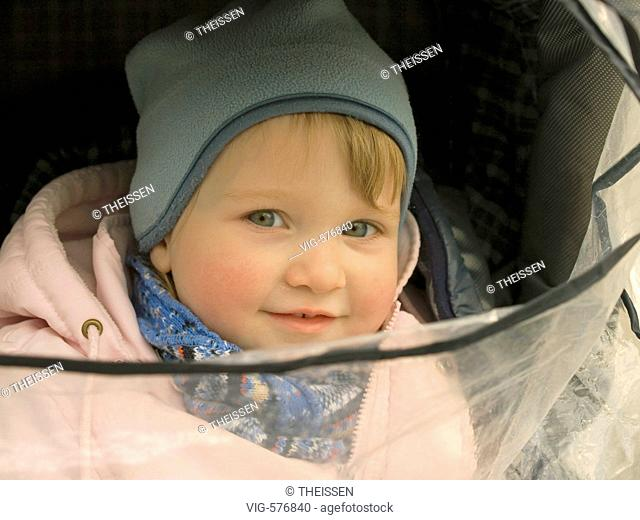 baby in baby buggy with rain shelter. - 02/03/2007
