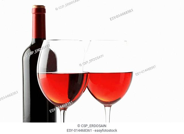 Two glasses of red wine and a bottle isolated