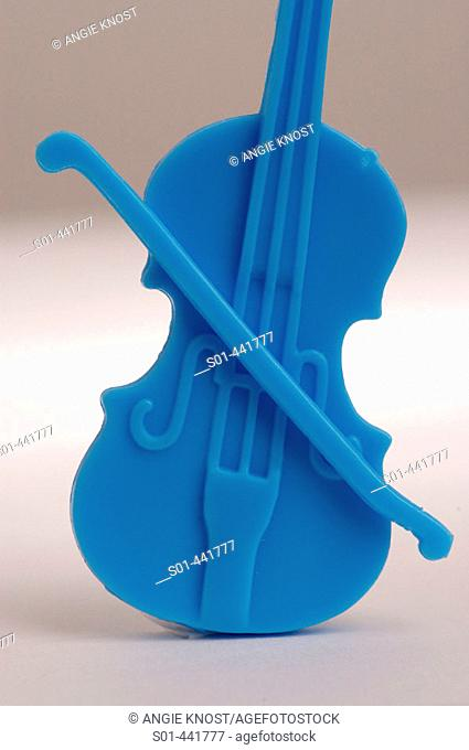 close-up of plastic toy violin