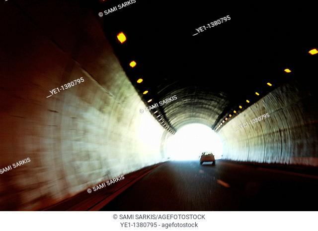 Car travelling inside a highway tunnel, Provence, France
