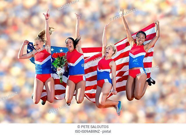 Four American athletes celebrating