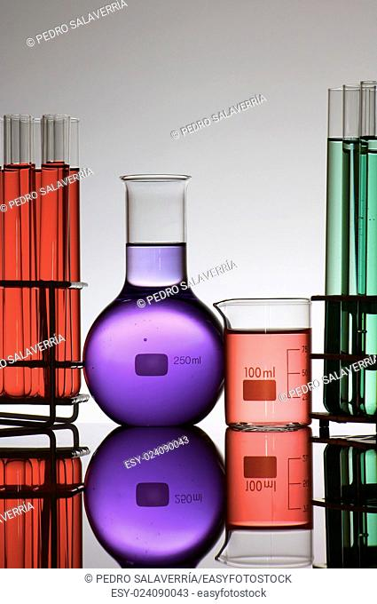 group of laboratory flasks with colored liquid